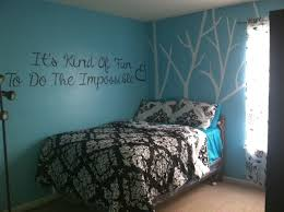 white branch and es sticker wall decal on teal bedroom wall color also single bedding in small boys room interior