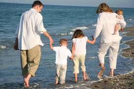 Family walking on the e=beach