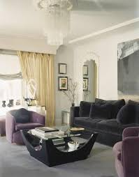 play with purple armchairs when using gold accents like in the curtains of this well appointed living room