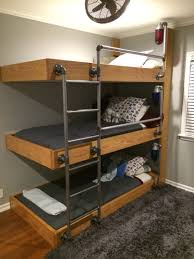 The triple bunk beds my engineer husband designed for our three ...