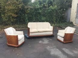 paire de fauteuils epoque art deco en placage de noyer et velours la maison bananas