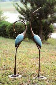 stylized crane garden pair sculpture