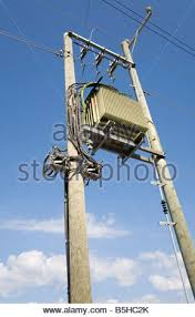 electricity supply wires from transformer to weather heads at 110 240 To Transformer Wiring step down transformer from 110 kilovolt to 220 240 volts stock photo 240 to 110 Transformers Symbols