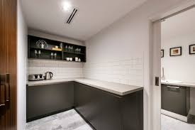 Sleek grey cabinetry and ceramic brick tiles bring the industrial ...
