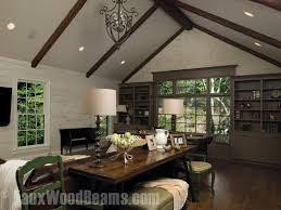 den with custom timber beams installed on the a frame ceiling