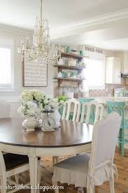 cote farmhouse style decorated in shades of white cream and aqua dining area kitchen
