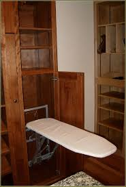 captivating unfinished work cabinet only with cotton fold down ironing board for household interior ideas