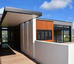 Modern looks too sterile in my opinion. We built this one in New Zealand  two years ago. It definitely makes people stop and look. I'd call it  contemporary.