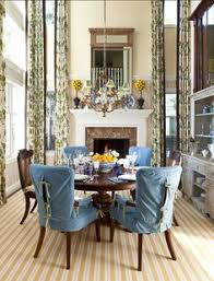 a dedicated dining room with ceilings is situated on the site of the former traditional living room and features understated touches such as blue slip