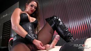 Sexy mistress Yasmin jerks the cum out of slaves cock Shameless