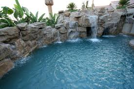 Rock wall with multiple waterfalls in this Southern California swimming pool.  Splash Pools and Construction