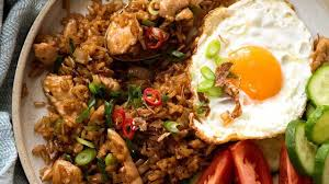 Heat the pan, sauteé garlic and shallots until golden brown and fragrant, then put the chicken in. Nasi Goreng Indonesian Fried Rice Recipetin Eats