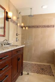 excellent bathroom is also tiled floor to ceiling with the same floor and wall