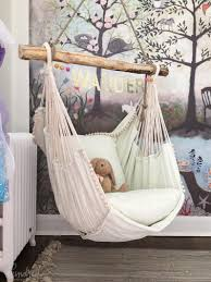 This hammock chair and woodland wall mural wallpaper are wonderful design  ideas for a baby nursery kidu0027s room or playroom  Unique Nursery and  Childrenu0027s