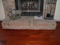 Here In This Photo Is The Finished Fireplace After Undercutting And  Installing Laminate Or Hardwood Flooring