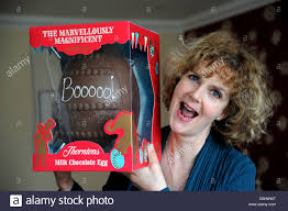 woman with a large thornton s chocolate easter egg with personalised writing iced on