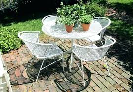 white round patio table chairs
