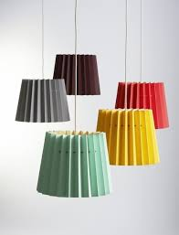 Above: Lane's Twin Tone Lampshades are made with two sheets of heavyweight  paper that are bonded together to show one color on the inside and another  on the ...