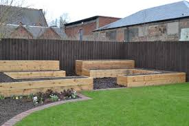 raised bed planters made with recycled wood made to fit garden