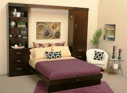 Making Space In A Small Bedroom Bedroom Small Brown Modern Wooden Wall Bed White Leather Arm