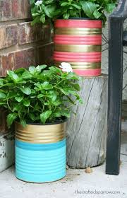 Painted tin cans make wonderful and customizable planters! Just remember to  punch a hole in