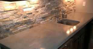 simple kitchen with concrete kitchen countertops st louis stacked stone tile kitchen backsplash and