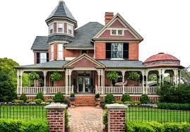 Large red brick with white trim victorian house with wrap around veranda and attached gazebo