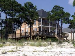 two story stucco home ideal for waterfront setting