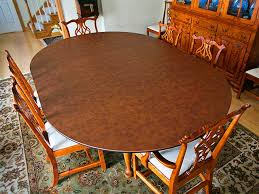 dining table enlarged using rounded table extender pad