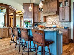 blue painted rustic kitchen island with wooden armless stools also teardrop pendant lighting as well as mosaic tile backsplash inspiration