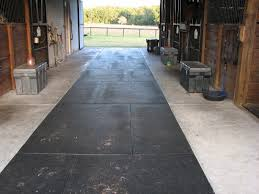 inlayed rubber mats on the main part of the barn aisle where horses