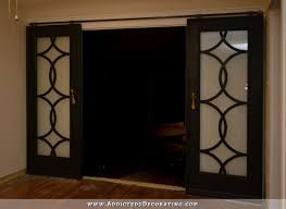 diy french doors with circle fretwork panels installed on rolling barn door style hardware