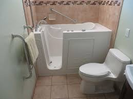 shown in the photos below is a walk in bathtub by access tubs the tile for the surround is from dal tile new larger window the new toilet is a kohler one