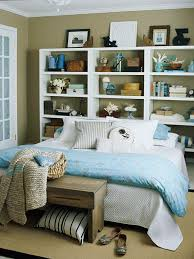 View in gallery Large and wide white bookshelf with beach-themed accessories