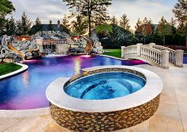 backyard pool with slides. Backyard Pool Design With Twin Slides Features Also Rock Stone Waterfall And Playful Round Tub Light Shows White Painted Bridge K