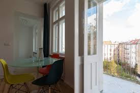 Main room kitchen and balcony view UrbanCocoon Berlin Furnished Apartment