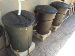 harvesting rainwater diy rain water collection system using standard 32 gallon plastic garbage cans