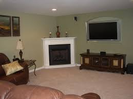 simple white surround corner fireplace with candles