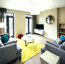 decoration meaning in bengali yellow rugs for living room gy stylish design combining grey sofas