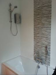 tiling around the window shower bath with feature tiles