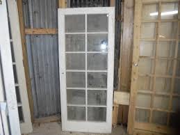 a reclaimed fully glazed door with plain glass