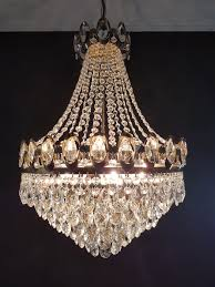 chandelier is set with cut glass crystals and almond crystals