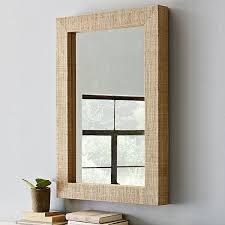 View in gallery Wall mirror with grass cloth frame