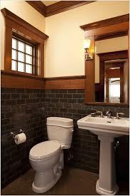 powder room craftsman arts and crafts bath lighting crown moulding framed mirror interior wall tile pedestal sink pedestal sinks powder room mirror subway