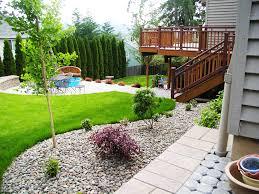 full imagas grey house wall design ideas combined with wooden fence low maintenance front yard flower