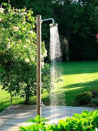outdoor foot shower a outdoor shower made of northern pine logs has a tap to turn