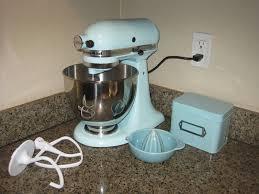 simple mixer a single orange rolls onto the stage to ice blue kitchenaid mixer b