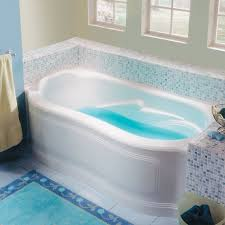 rectangle bath with curved front skirt and raised bathrest