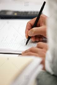 Scientist Writing Notes On Graph Paper Stock Photo Offset