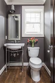 traditional powder room with american standard retrospect console table with bathroom sink limestone counters